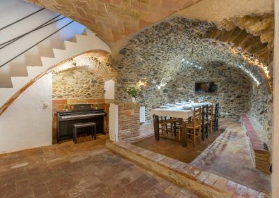 Stone Vaulted Dining Room and Stairs to Second Floor